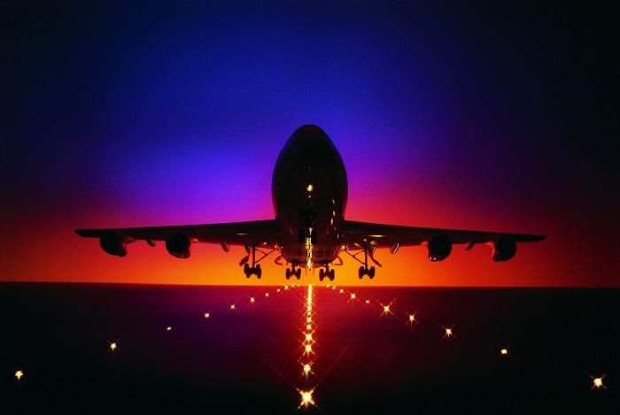 plane taking off dusk