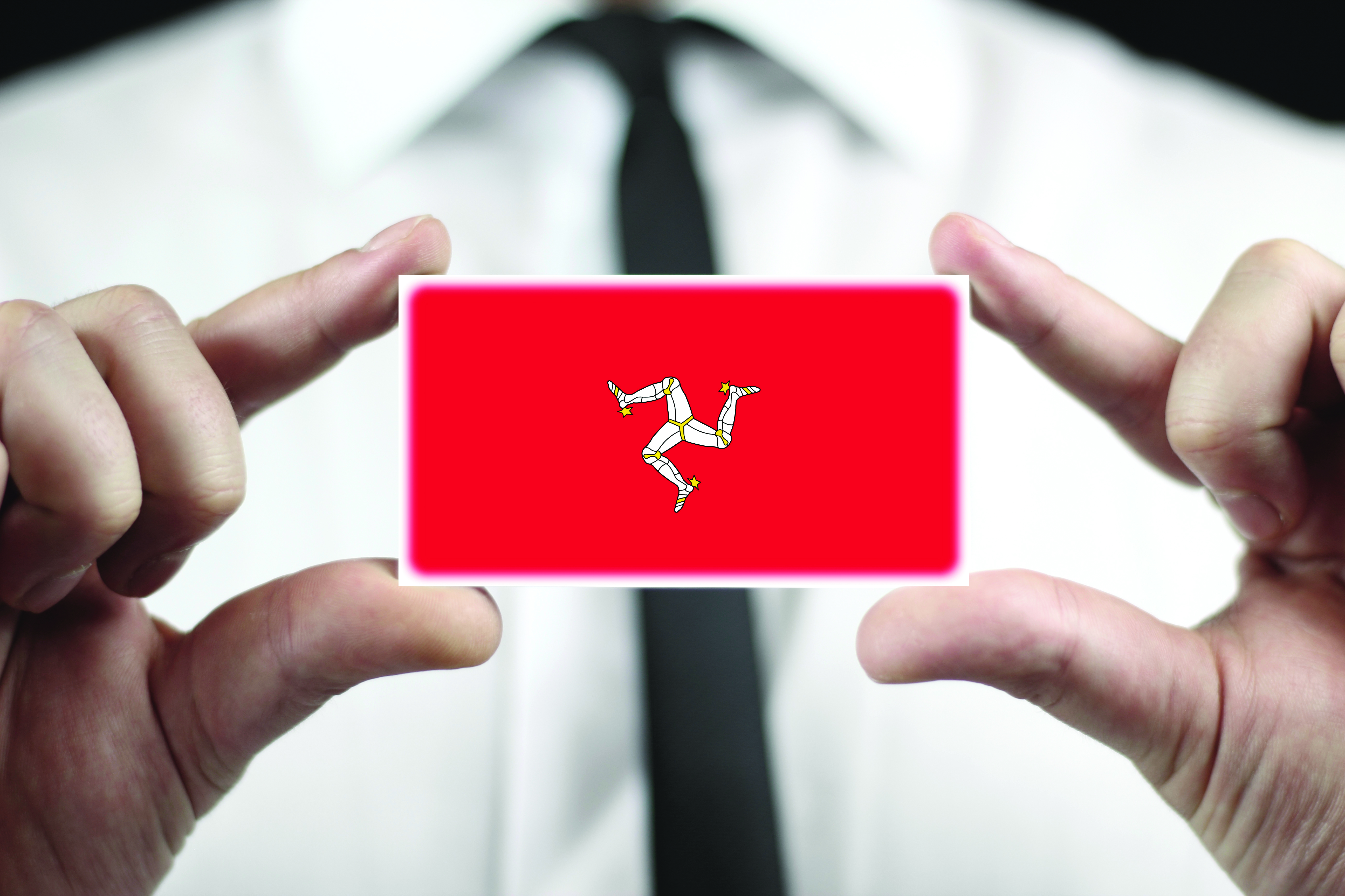 Businessman holding a business card with Isle of Man Flag ...